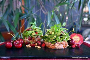 BBQ Duck with Honey Plum Sauce, Micro-Salad and Cherries